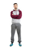 Young happy bearded casual man in sportswear with crossed hands Royalty Free Stock Image