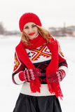 Young happy beautiful blonde girl (27 years) on the snow background royalty free stock photography