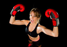 Young happy beautiful boxer girl with boxing gloves arms in victory sign with fit and healthy body Stock Photo