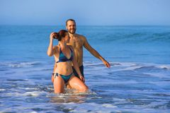 Happy and beautiful couple enjoying Summer holidays travel or honeymoon trip together in tropical paradise beach having fun. Young happy and beautiful couple stock image