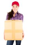 Young happy beautiful delivery girl carrying Stock Image