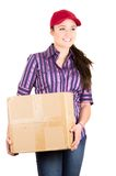 Young happy beautiful delivery girl carrying Stock Photography