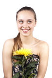 Young happy beautiful girl with a flower Royalty Free Stock Photo
