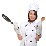 Young and happy beautiful girl preparing lunch Stock Images