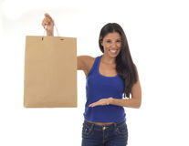 Young happy and beautiful hispanic woman holding brown shopping Royalty Free Stock Image