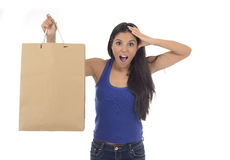 Young happy and beautiful hispanic woman holding brown shopping Royalty Free Stock Images