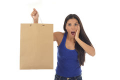 Young happy and beautiful hispanic woman holding brown shopping Royalty Free Stock Photography