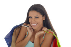 Young happy and beautiful hispanic woman holding color shopping bags smiling excited isolated Royalty Free Stock Photography