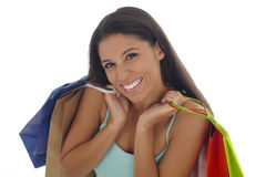 Young happy and beautiful hispanic woman holding color shopping bags smiling excited isolated Stock Photos