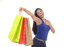 Young happy and beautiful hispanic woman holding color shopping bags smiling excited isolated. On white background in shopaholic fashion sales and consumerism stock photography