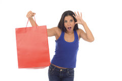 Young happy and beautiful hispanic woman holding red shopping bag smiling excited isolated on white Royalty Free Stock Photography