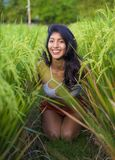 Young happy and beautiful latin woman smiling playful having fun posing sexy isolated on green rice field in Asia tourist trip and. Summer holidays travel and stock images