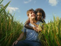 Young happy and beautiful mixed ethnicity couple with black African American woman and attractive Caucasian man cuddling and. Young happy and beautiful mixed royalty free stock photography
