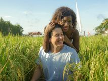 Young happy and beautiful mixed ethnicity couple with black afro American woman and attractive Caucasian man cuddling and having. Young happy and beautiful mixed royalty free stock photography