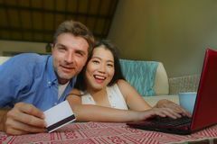 Young happy and beautiful mixed ethnicity couple with Caucasian husband or boyfriend and Asian Chinese woman wife or girlfriend stock photos