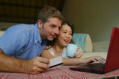 Young happy and beautiful mixed ethnicity couple with Caucasian husband or boyfriend and Asian Chinese woman wife or girlfriend royalty free stock images