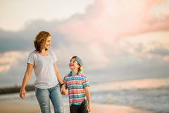 Young happy beautiful mother and her son having Royalty Free Stock Photo