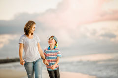 Young happy beautiful mother and her son having Royalty Free Stock Images