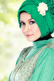 Young happy beautiful muslim woman with green costume wearing hi Stock Images