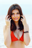 Young happy beautiful woman on the beach Stock Photos