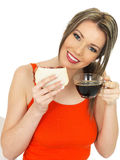 Young Happy Beautiful Woman With a Black Coffee and Bacon Sandwich Royalty Free Stock Photos
