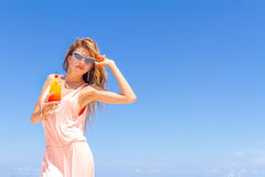 Young happy beautiful woman with bright tropical cocktail Stock Photo