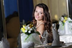 Young happy beautiful woman in restaurant Royalty Free Stock Photos