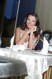 Young happy beautiful woman in restaurant Stock Images