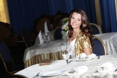 Young happy beautiful woman in restaurant Royalty Free Stock Photography