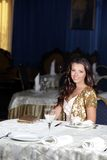 Young happy beautiful woman in restaurant Royalty Free Stock Images