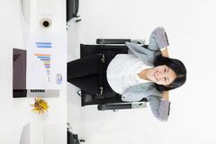 Young happy beautiful woman sitting and relax in office royalty free stock image