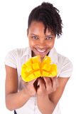 Young happy black / african american woman holding fresh mango Stock Images