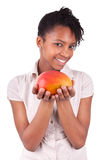 Young happy black / african american woman holding fresh mango Stock Image