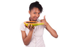Young happy black / african american woman holding fresh papaya Stock Images