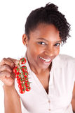 Young happy black / african american woman holding tomatoes Stock Photo