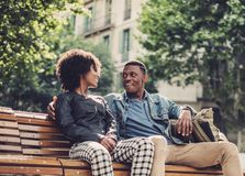 Young happy black couple outdoors. Young happy black couple in a park Royalty Free Stock Image