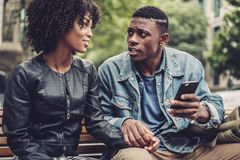 Young happy black couple outdoors. Young happy black couple in a park Stock Images