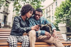 Young happy black couple outdoors. Young happy black couple in a park Royalty Free Stock Photo
