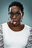 Young Happy Black Woman Sticking Out Her Tongue Stock Image