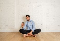Young happy blogger with mobile phone taking video or selfie for blog at new home royalty free stock photography