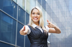 A young and happy blond Caucasian businesswoman Stock Images