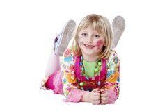 Young happy blond disguised girl on the floor Stock Images