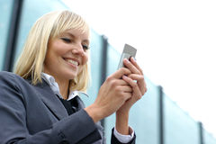 A young and happy blond on the mobile phone Stock Image