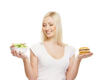 A young and happy blond woman holding food Stock Photography
