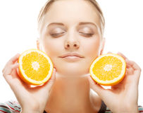 Young happy blond woman with orange Stock Photo