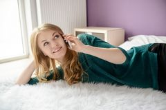 Young happy blond woman talking on the phone Stock Photography