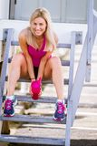 Young happy blonde girl doing sport in the city Stock Photography