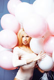 Young happy blonde real woman with baloons smiling close up, lifestyle people concept Royalty Free Stock Images
