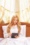 Young happy  blonde woman in the bed Royalty Free Stock Images
