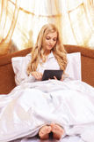 Young happy  blonde woman in the bed Royalty Free Stock Photos